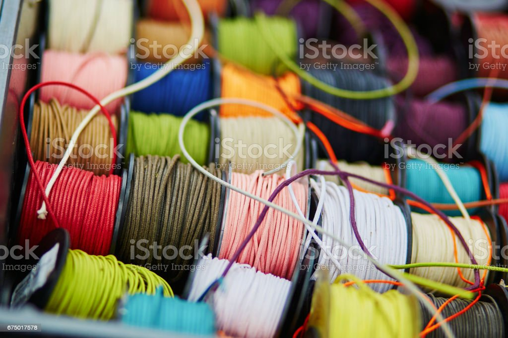 Spools with rope of different colors for sewing or crafting stock photo