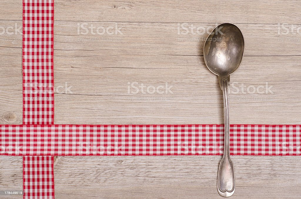 Spoon an red checkered ribbon royalty-free stock photo