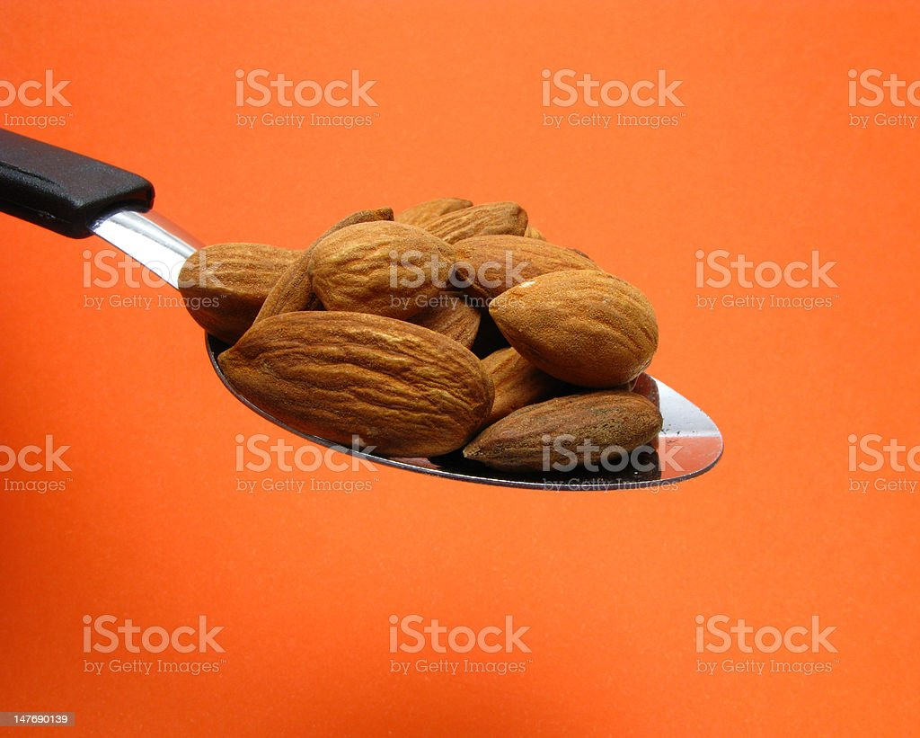 spoon and almonds royalty-free stock photo