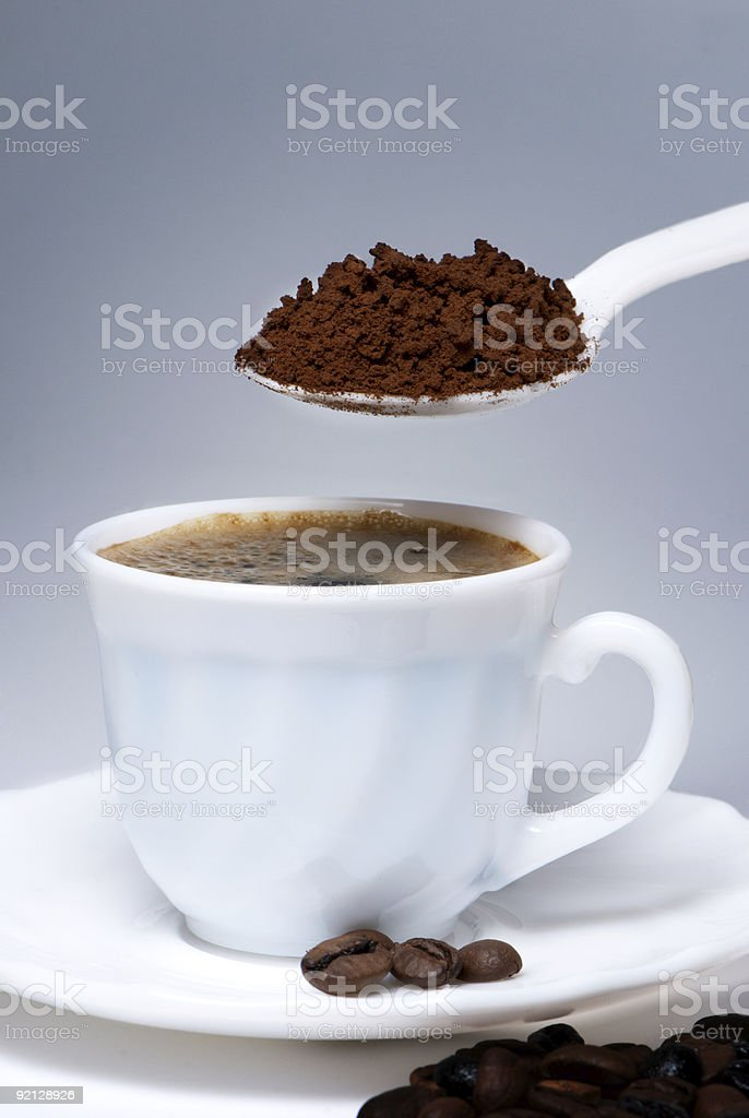 Spoon and Cup of coffee royalty-free stock photo