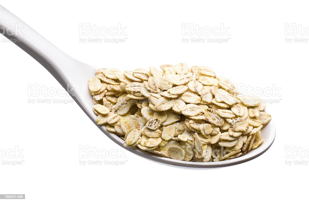 spoon and oatmeal royalty-free stock photo