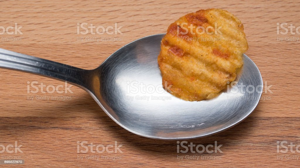 Spoon and Potato chips stock photo