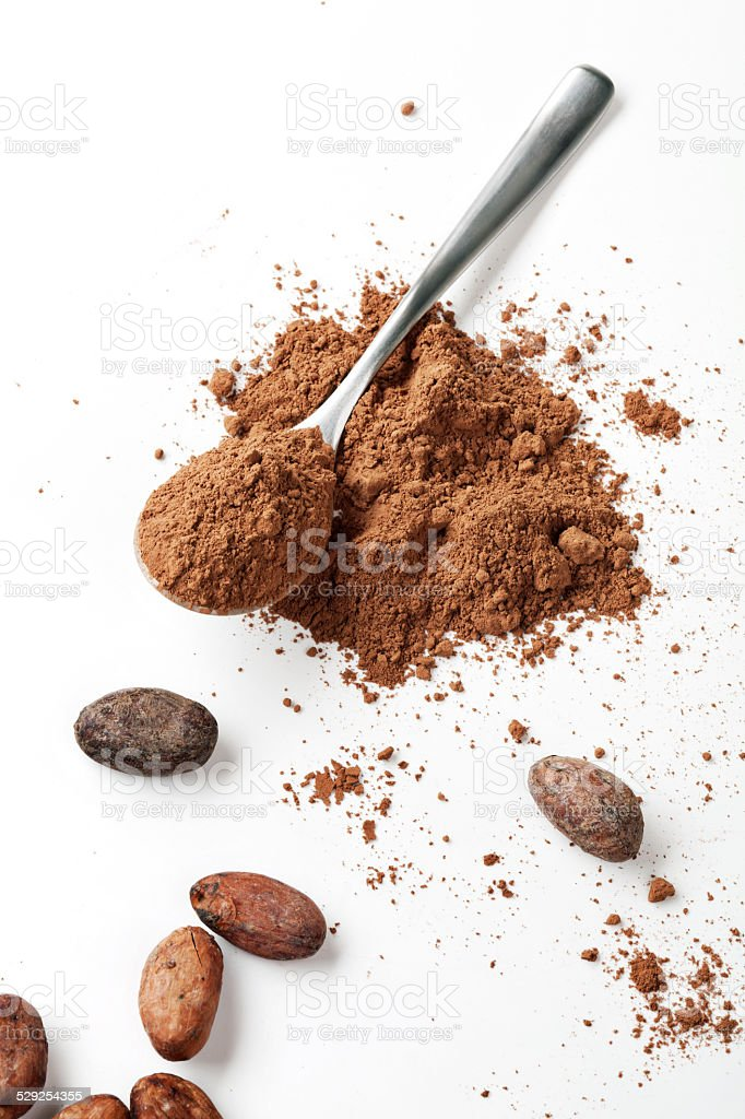 Spoon Cocoa Powder and Cocoa Beans stock photo