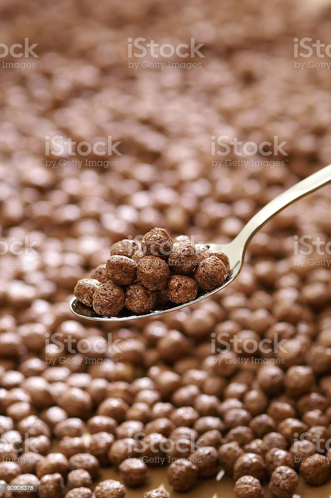 Spoon filled with chocolate balls royalty-free stock photo