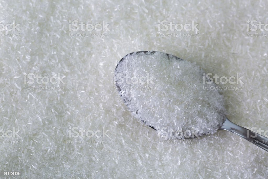 Spoon full of MSG flakes, Monosodium glutamate, sodium salt used as flavor enhancer stock photo