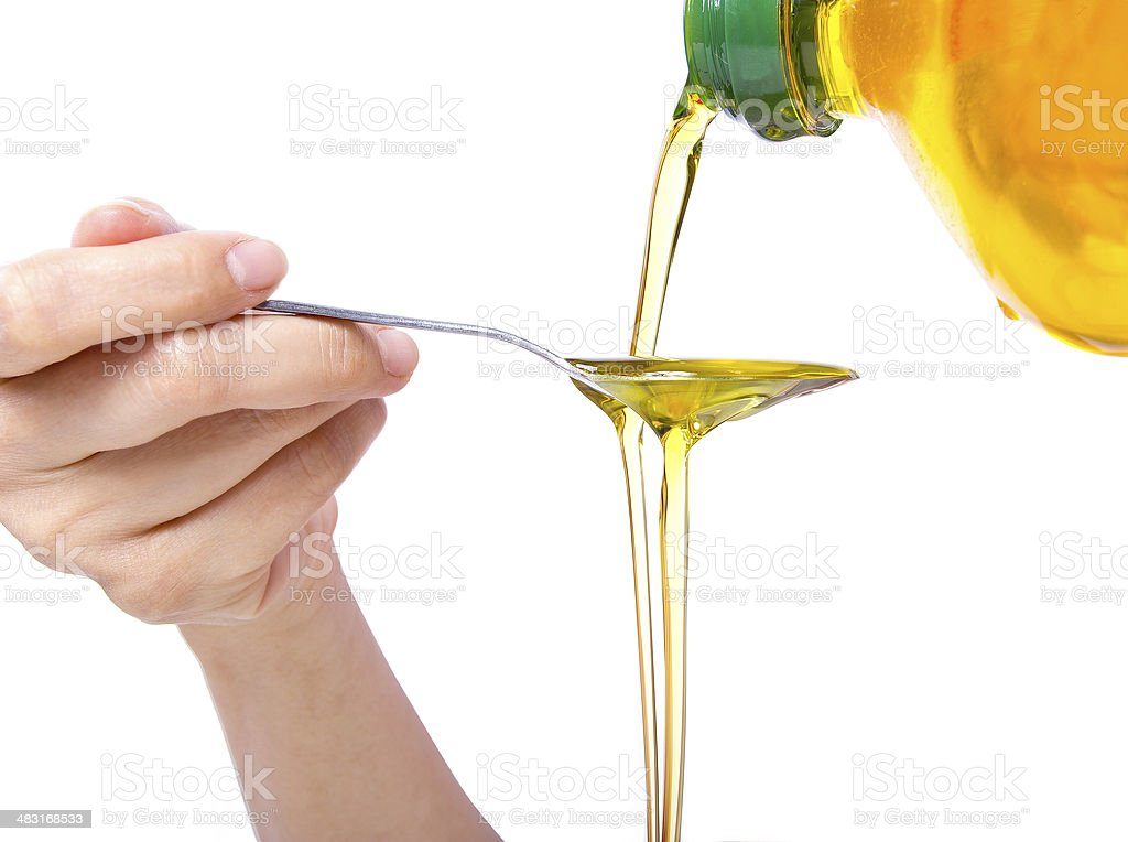 Spoon Full of Oil for Oil Pulling or Swishing stock photo