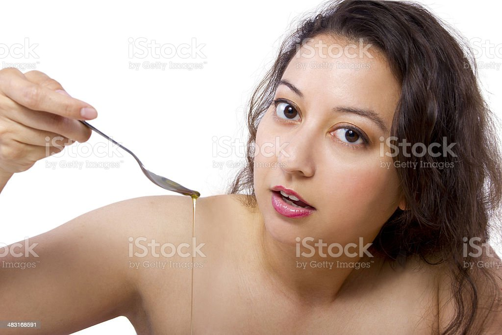 Spoon Full of Oil for Oil Pulling or Swishing stock photo