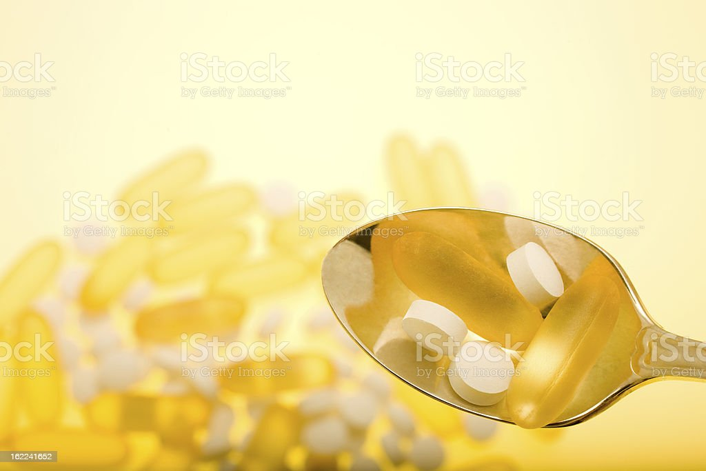 Spoon Holding Pills royalty-free stock photo