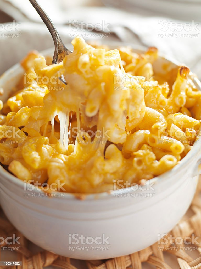 Spoon in a bowl of macaroni and cheese stock photo