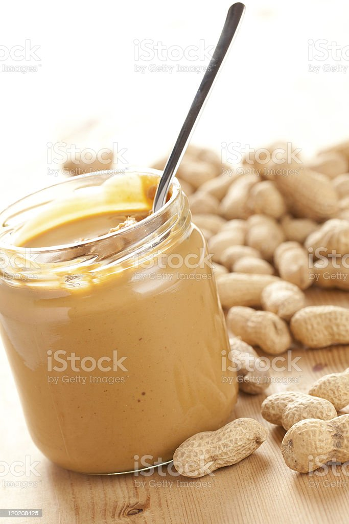 A spoon in a jar of peanut butter royalty-free stock photo