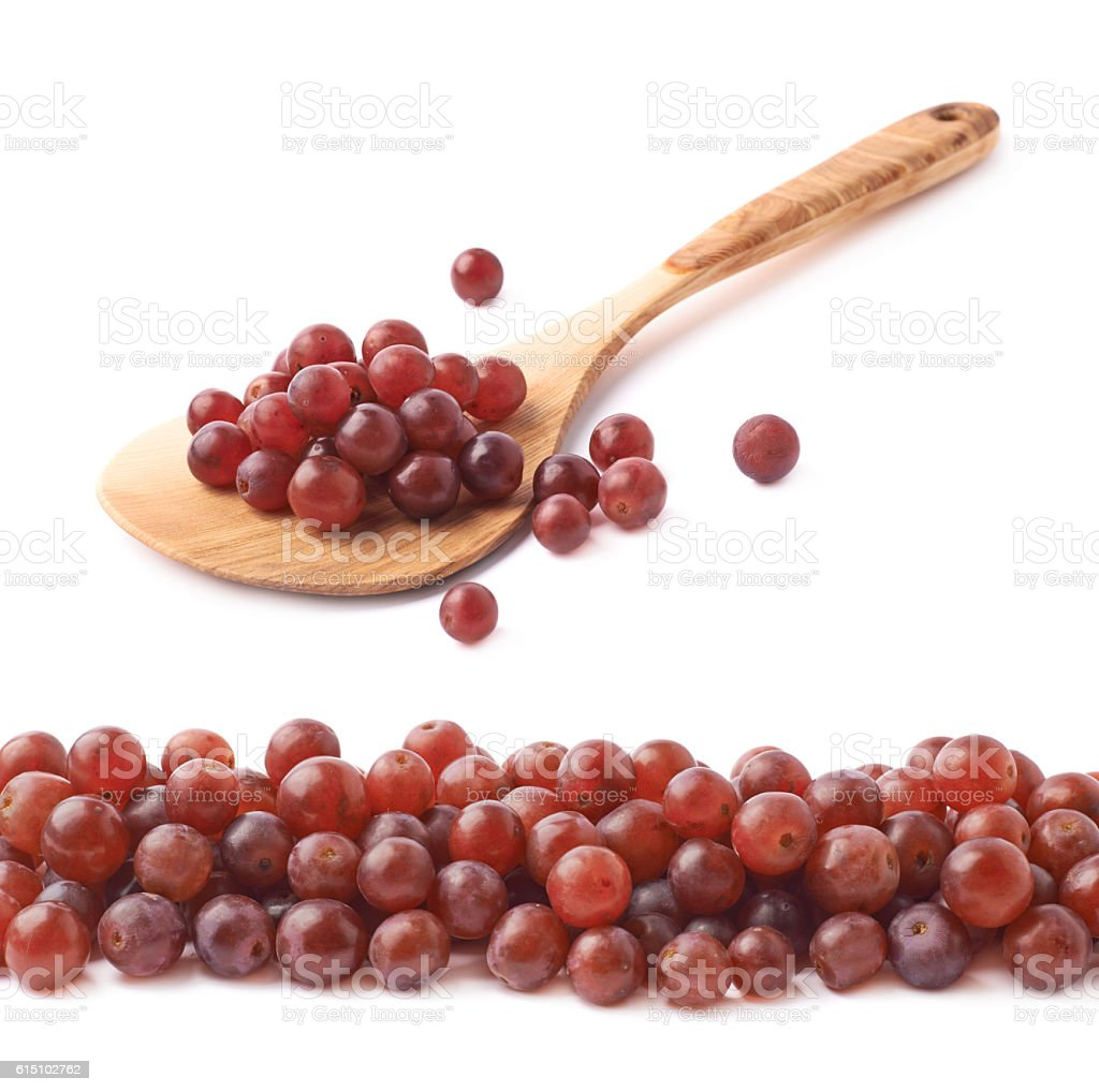 Spoon ladle filled with dark grapes stock photo