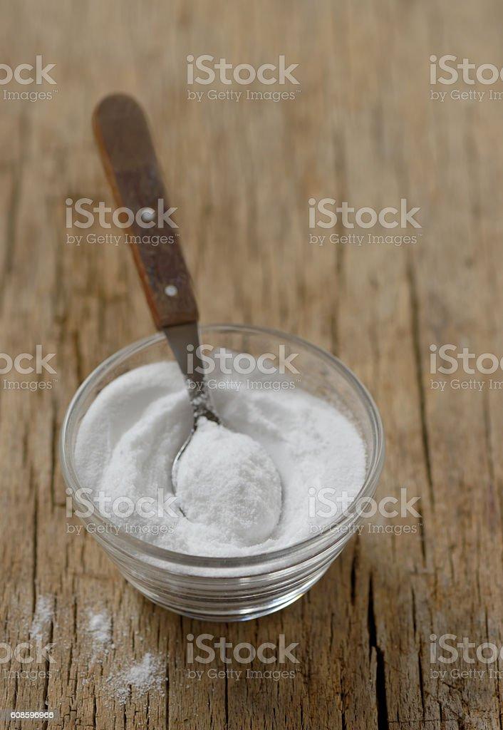 Spoon of baking soda in bowl stock photo