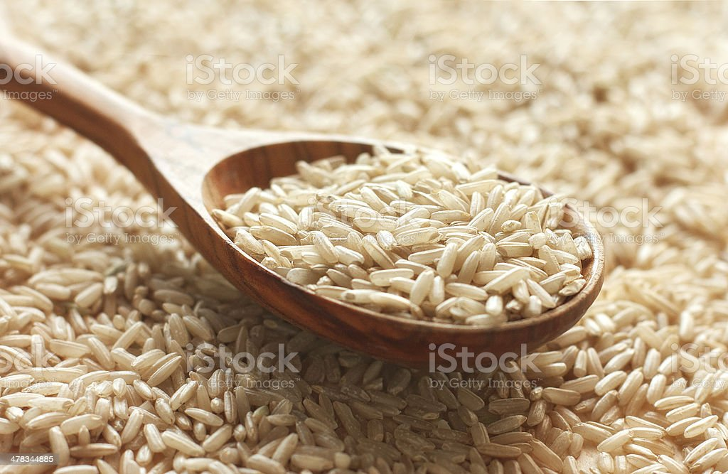 Spoon of brown rice stock photo