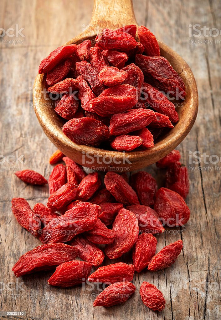 spoon of dried goji berries stock photo