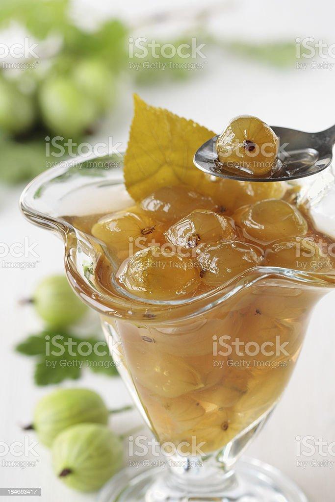 Spoon of green gooseberry jam royalty-free stock photo
