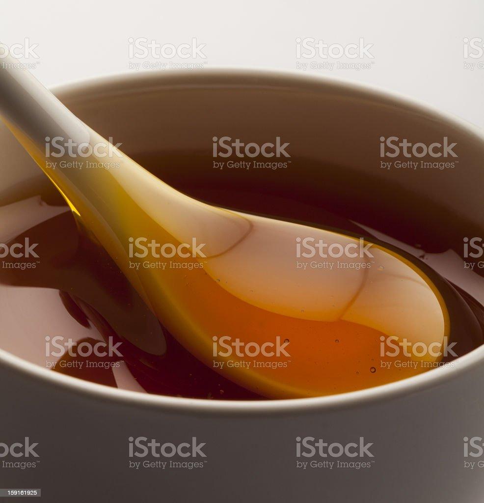 Spoon of honey royalty-free stock photo