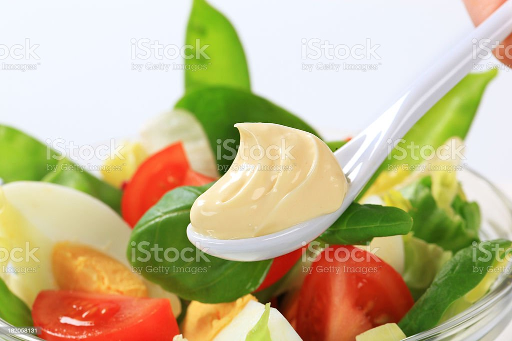 Spoon of mayonnaise stock photo