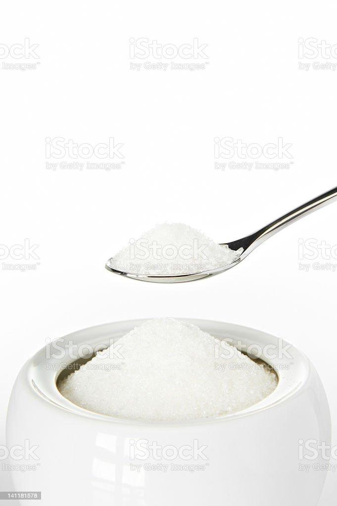 Spoon of sugar closeup stock photo