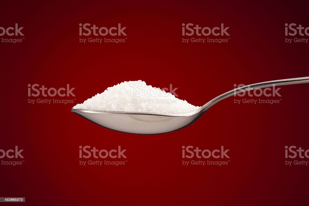 Spoon of sugar stock photo