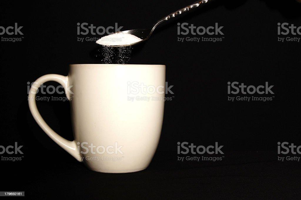 Spoon Pouring Sugar Into Coffee Mug royalty-free stock photo