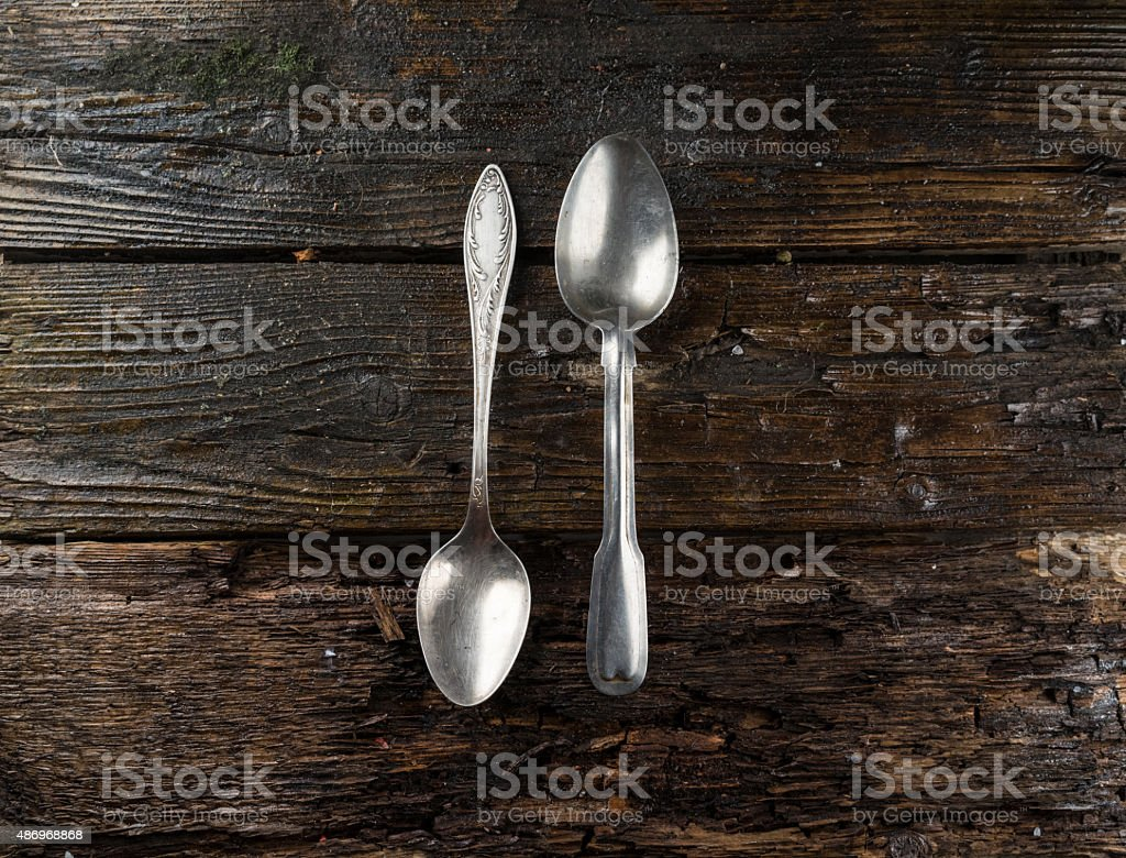 Spoon to eat lying on an old wooden table stock photo