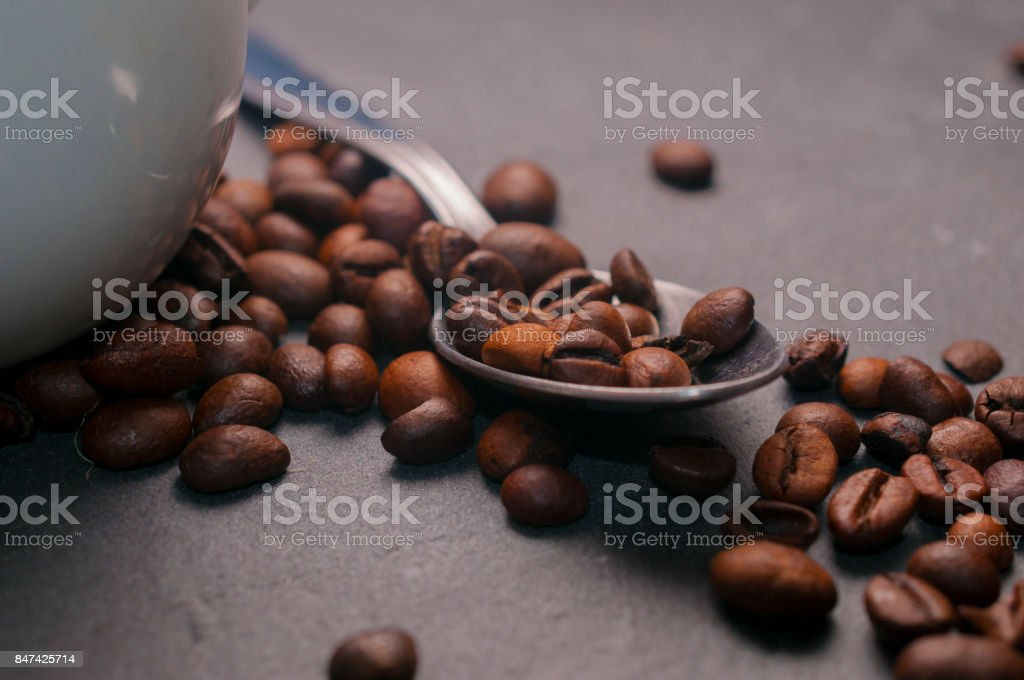 Spoon with coffee beans stock photo