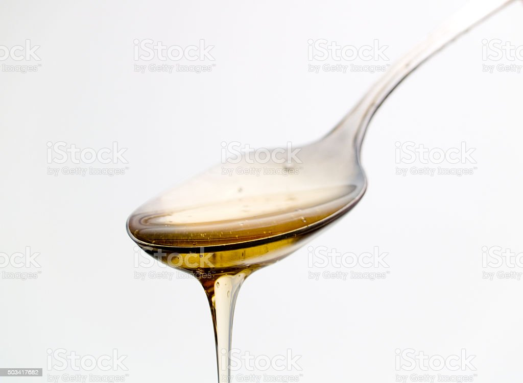 Spoon with honey stock photo