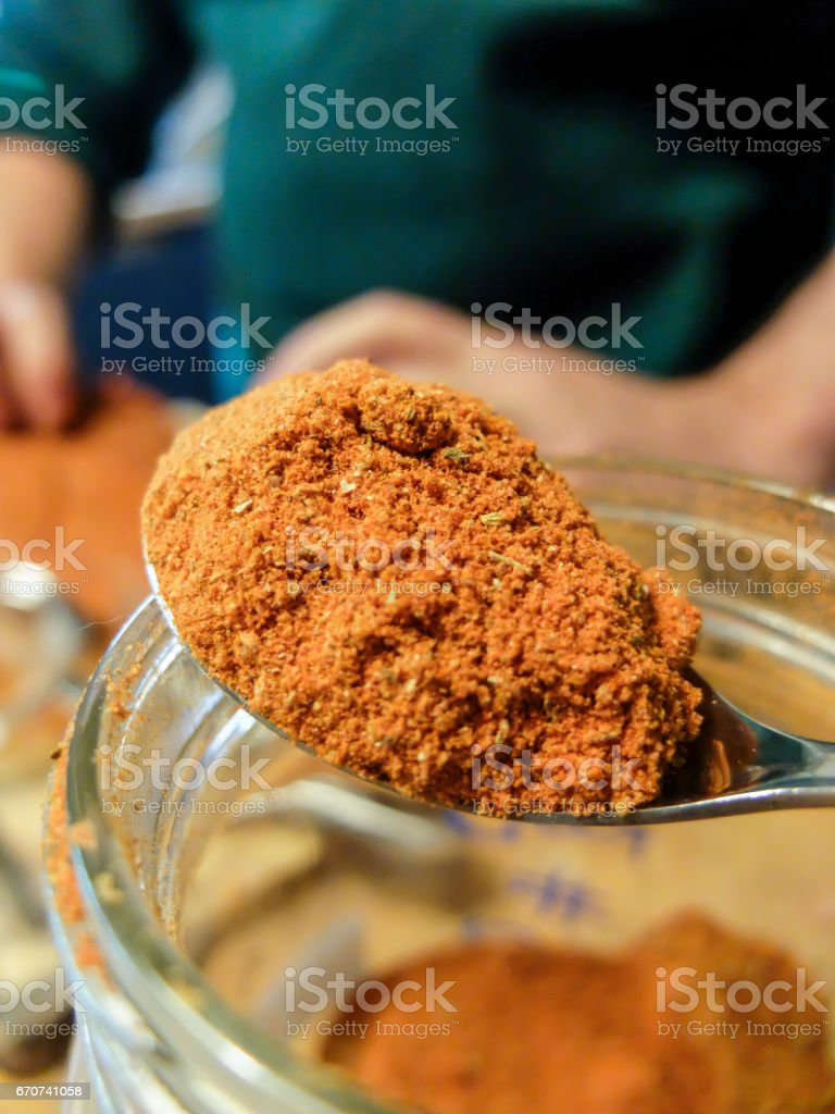 Spoon with ready mix rub containing paprika and other spices stock photo