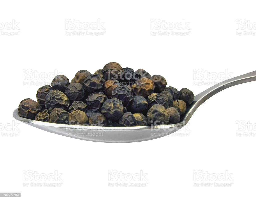 Spoonful black pepper grains, isolated teaspoon spoon detailed macro closeup stock photo