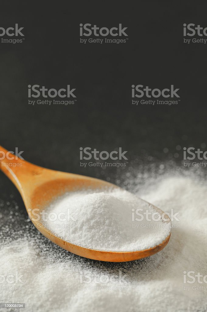 Spoonful of bicarbonate royalty-free stock photo