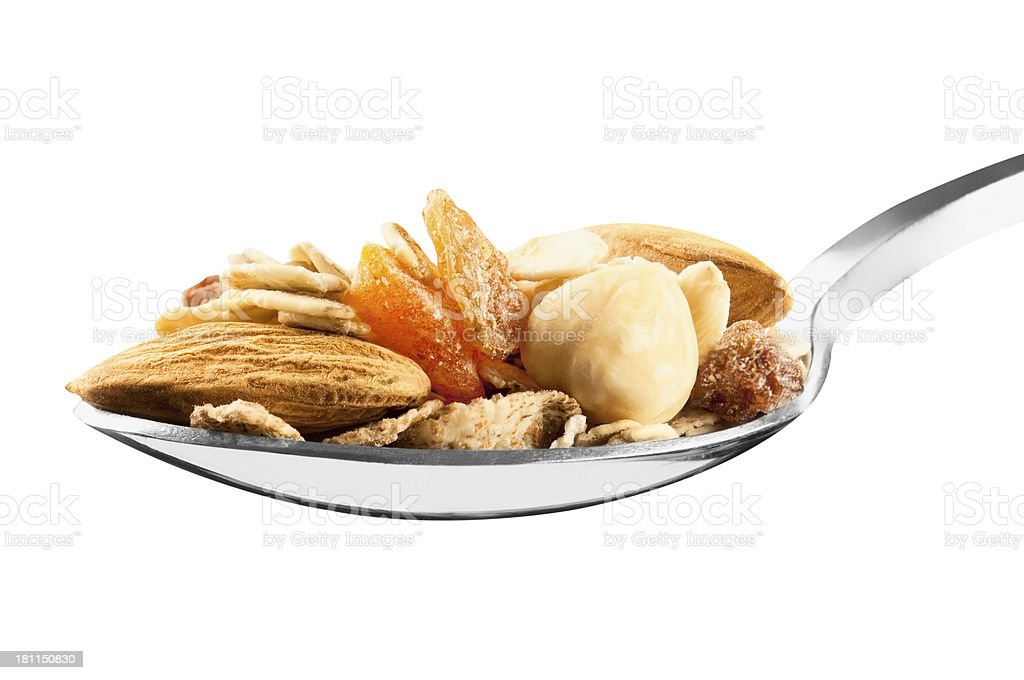 Spoonful of fruit and nut muesli on a dessert spoon stock photo