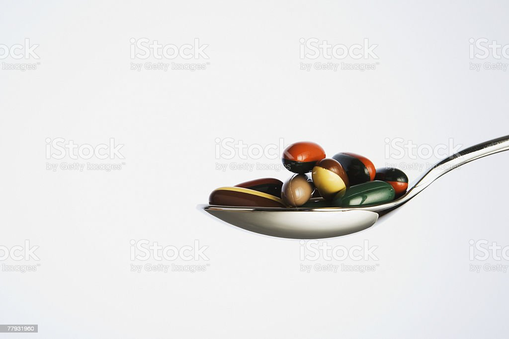 Spoonful of pills royalty-free stock photo