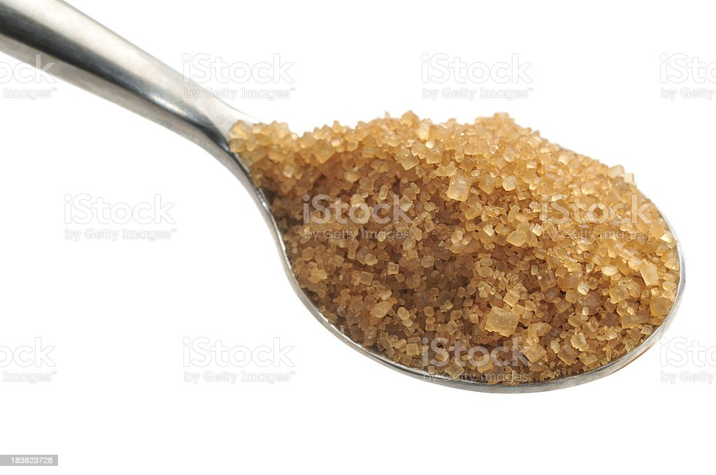 Spoonful of Raw Cane Sugar royalty-free stock photo