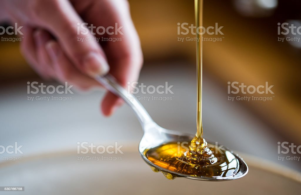 Spoonful of Syrup stock photo