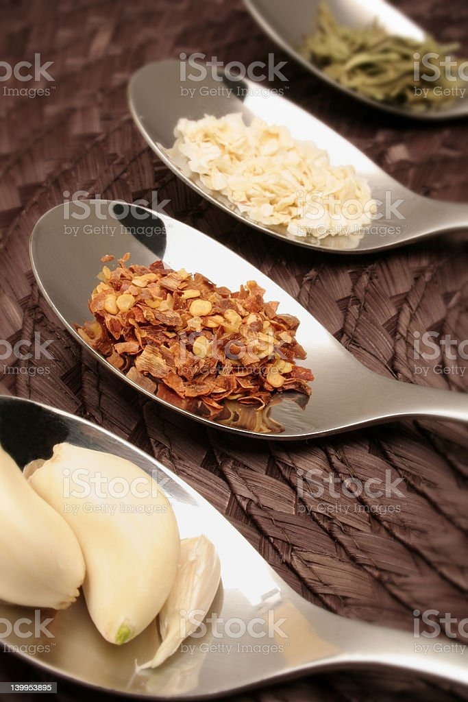 Spoons and fine herbs royalty-free stock photo