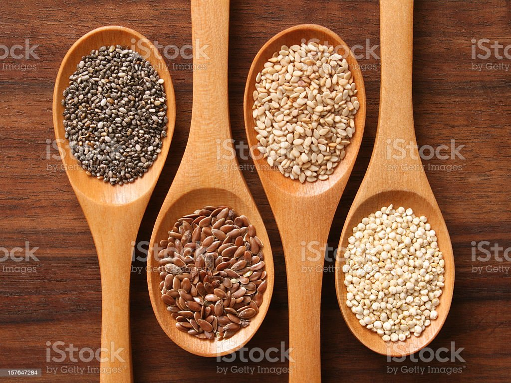Spoons and healthy seeds stock photo