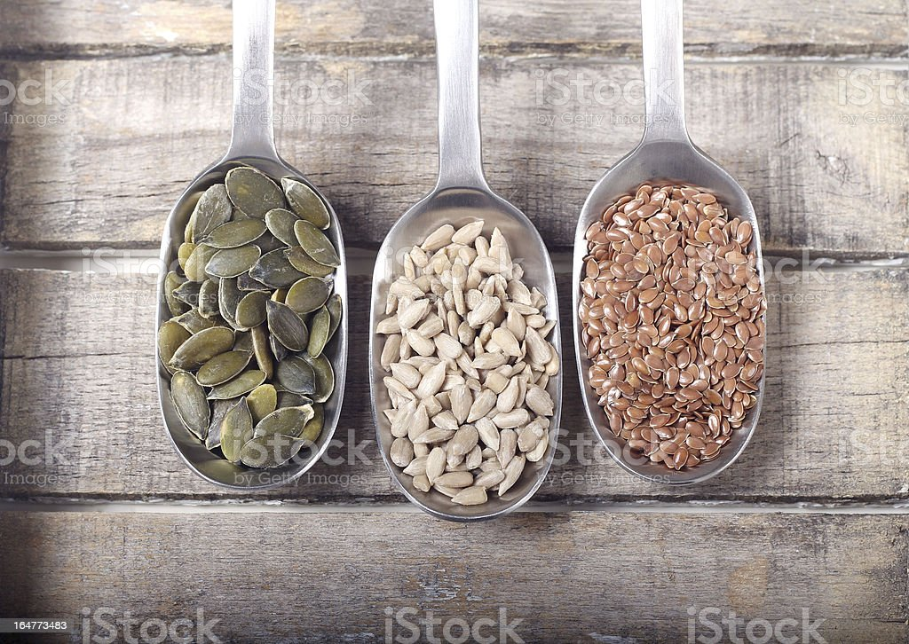 Spoons full of seeds royalty-free stock photo