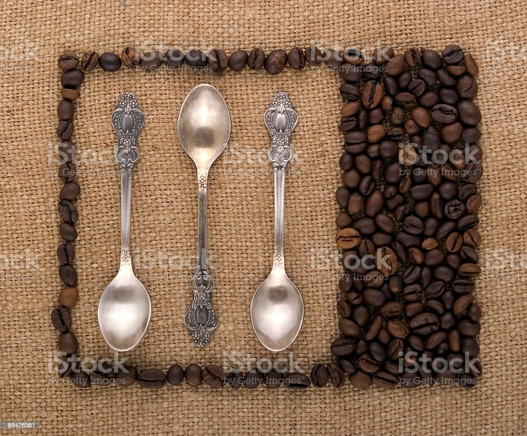 Spoons of coffee beans royalty-free stock photo