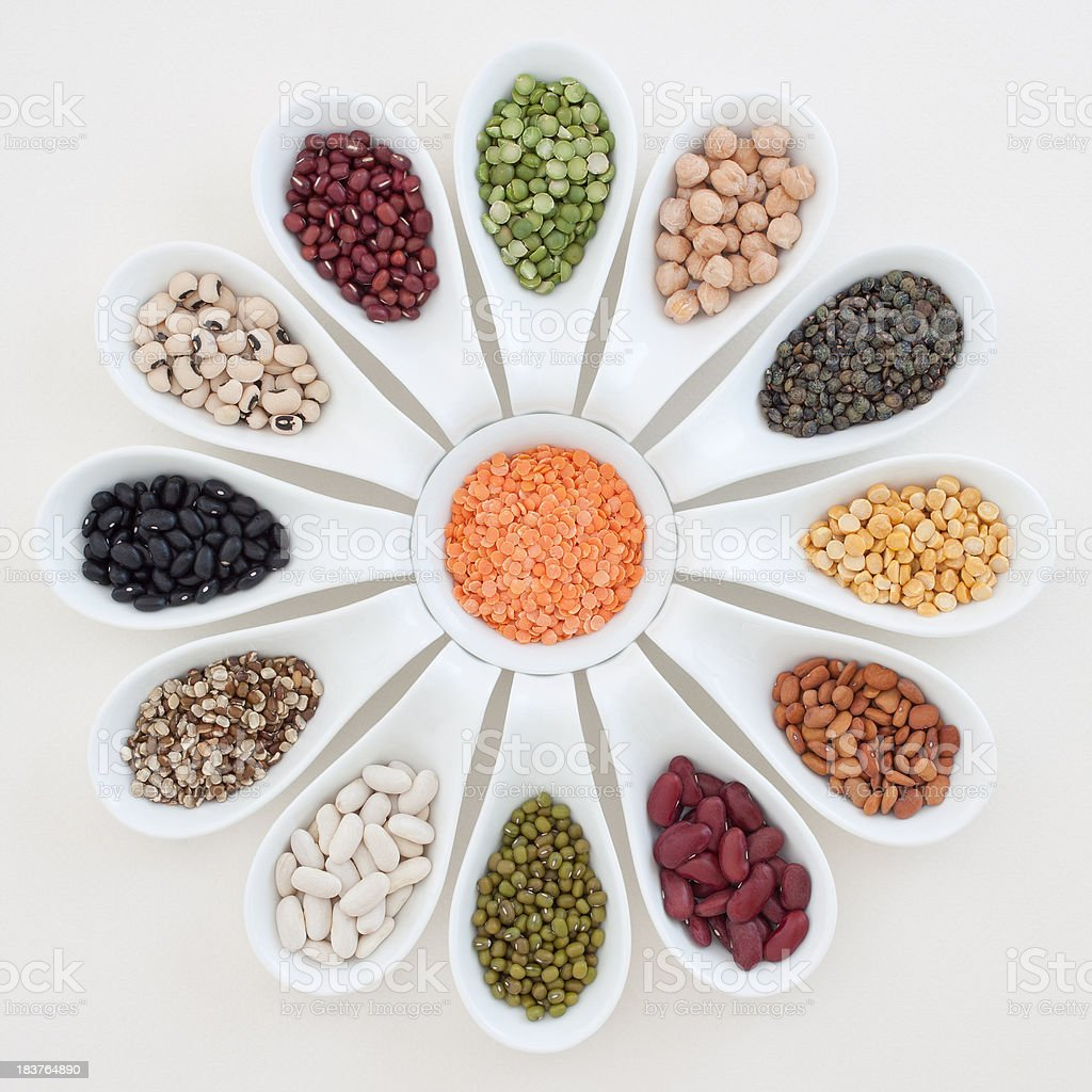 Spoons with beans, lentils and peas stock photo