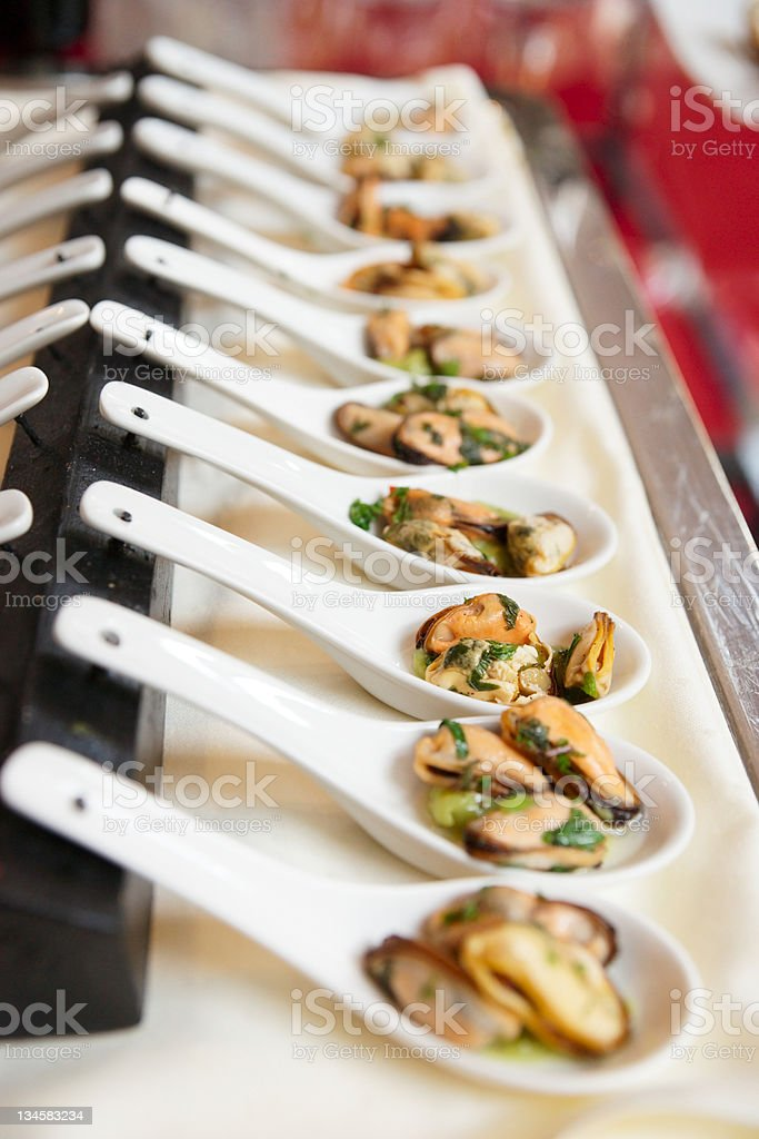 Spoons with mussels royalty-free stock photo
