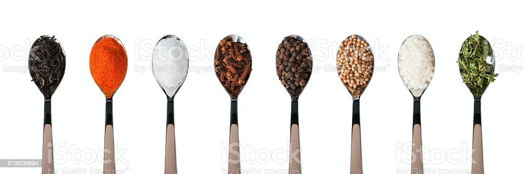 Spoons with spices on white background stock photo