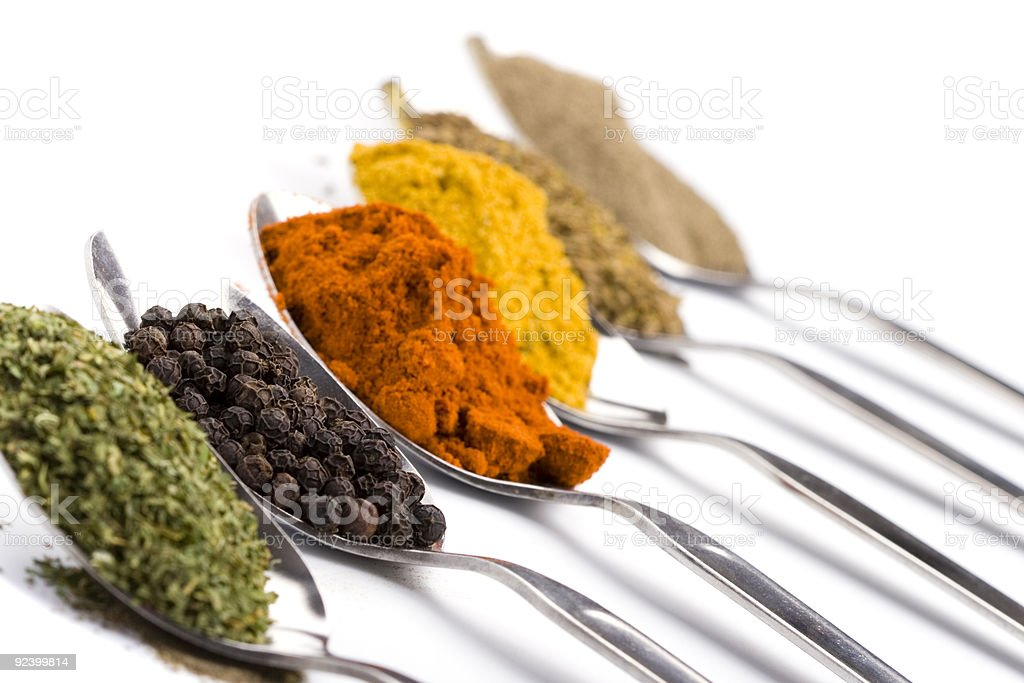 spoons with various ground spices royalty-free stock photo