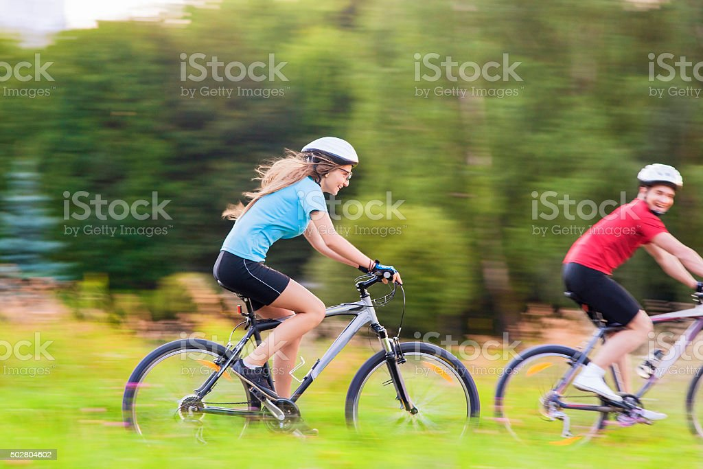 Sport and Bicycles Concept: Young Caucasian Couple Having a Spee stock photo