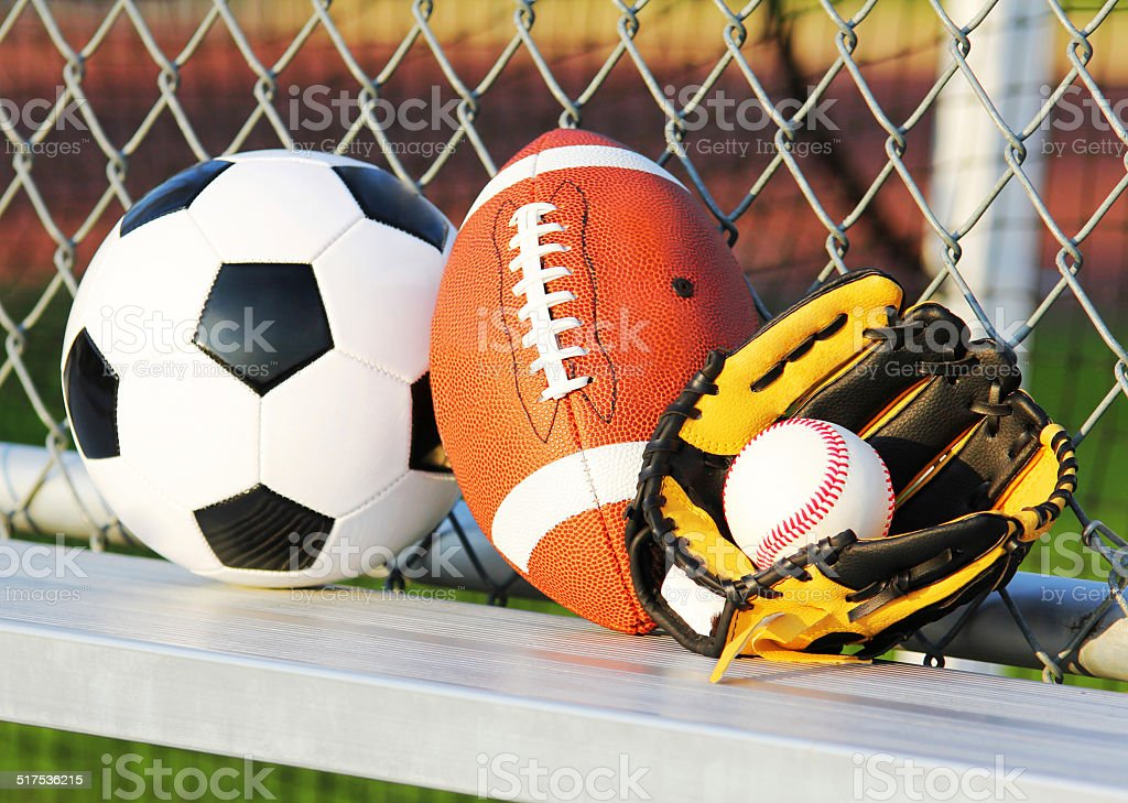 Sport balls. Soccer ball, american football and baseball in yellow...