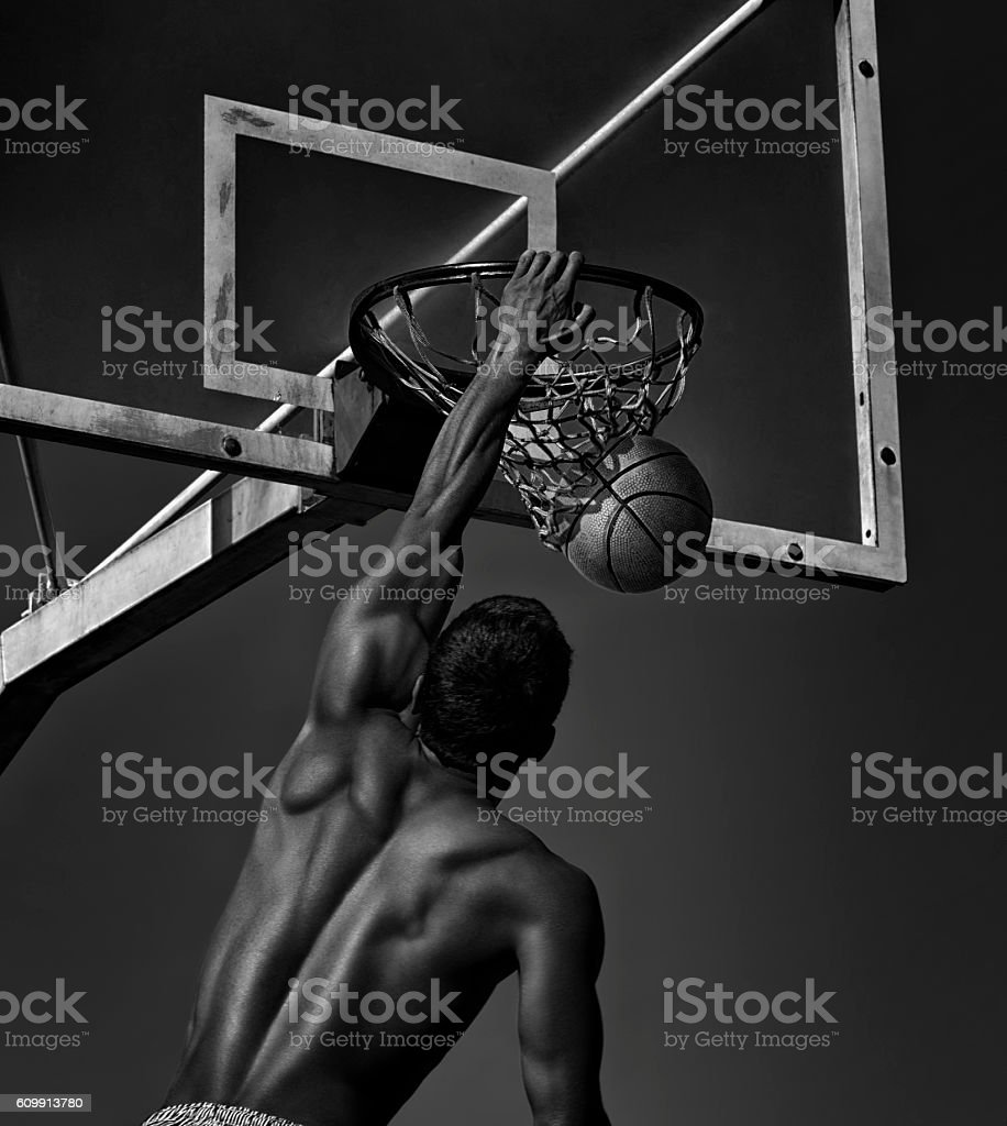 Sport. Basketball player in action -- black and white toned stock photo