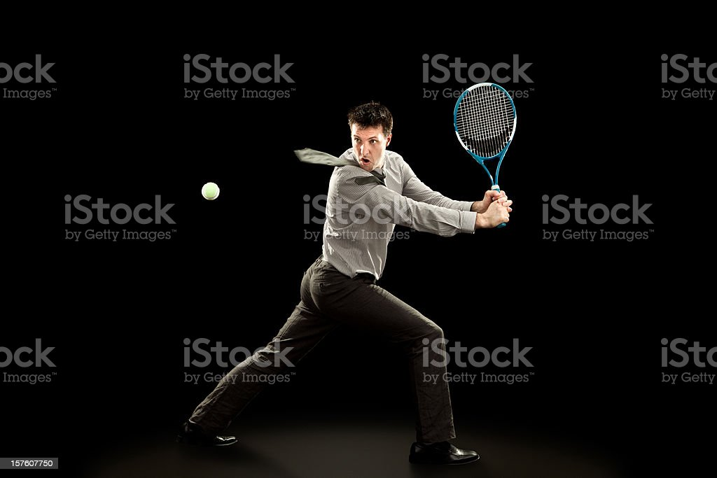 sport business man plays tennis on black background royalty-free stock photo