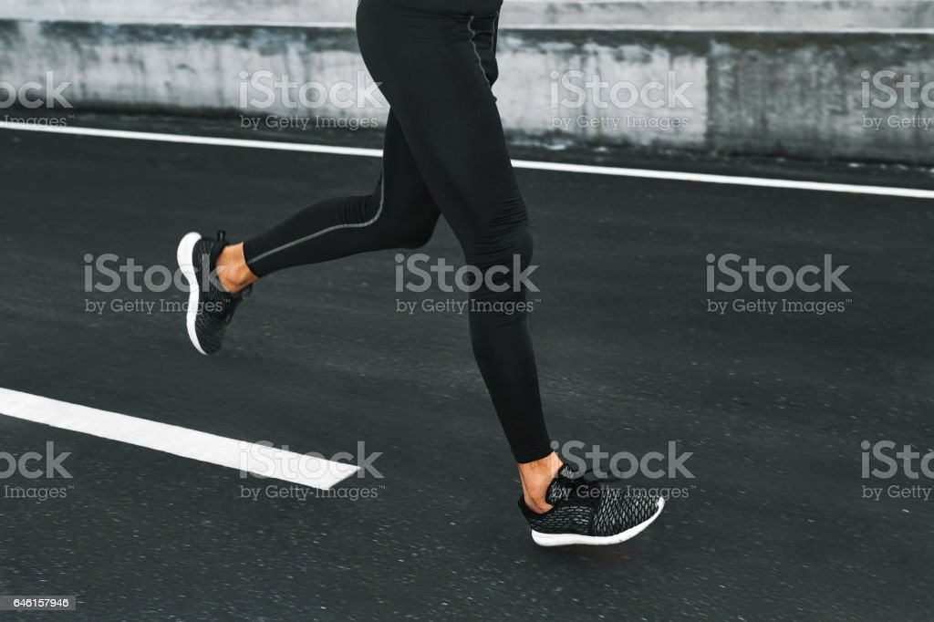 Sport. Close Up Of Male Legs Running On Road Outdoors. stock photo