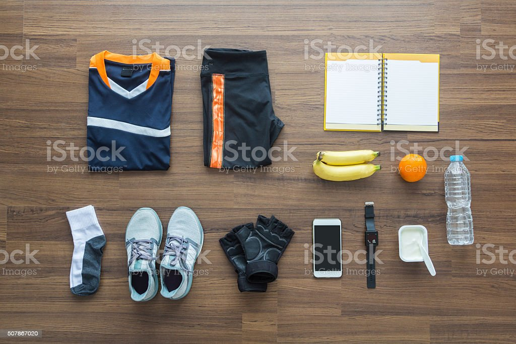 Sport clothes and accessories on a wooden background stock photo
