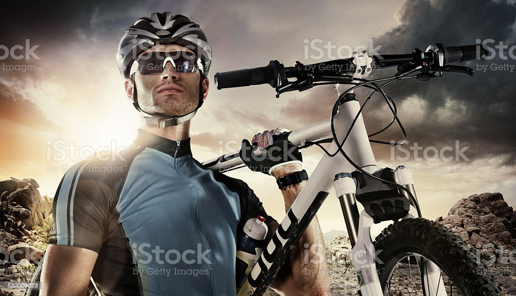 Sport. Cyclist carry a bike on dramatic sky. stock photo