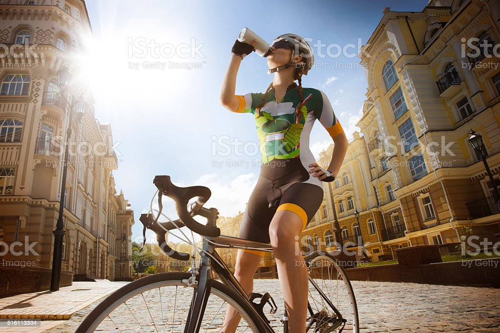 Sport. Cyclist drinking water stock photo